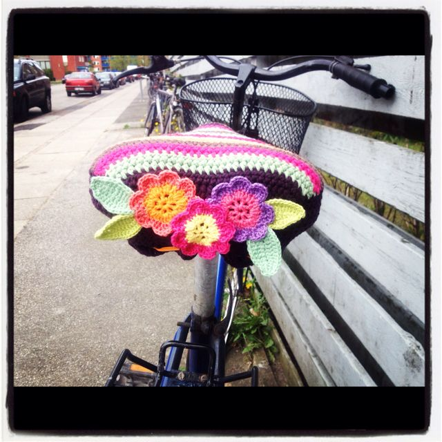 Crochet bike seat cover- oh I just know katie will want one!!!  Lol