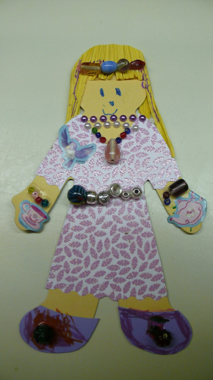 My daughters paper doll for school. The random beads we had in the house worked nicely to add something a little extra to her doll.