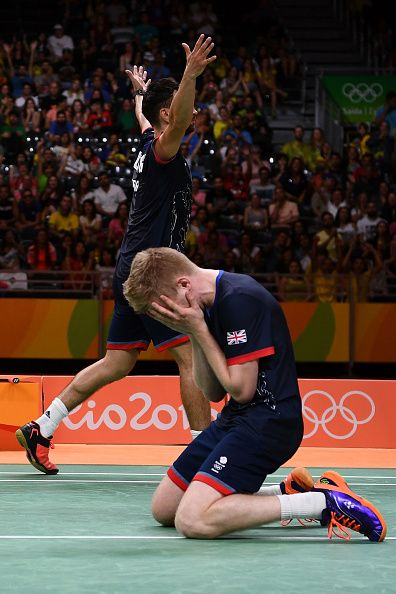 Chris Langridge and Marcus Ellis of Great Britain celebrate winning match point…
