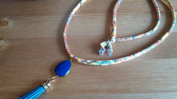 handmade necklace with a big blue stone and a tuft by toocharmy
