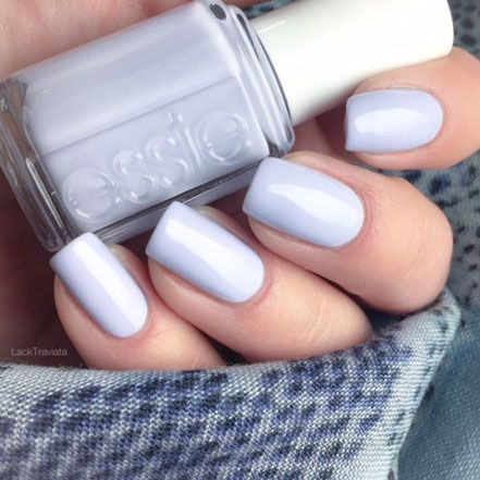"""Essie- Virgin Snow- this is a delightful icy periwinkle cream, not really a blue as shown in photo It's eye catching without being """"in your face"""". No streaks, good wear time (survived through all the Christmas cooking, eating, clean-up, and gift unwrapping).I paired this with Essie's Set In Stones (applying Set in Stones at the cuticle and dabbing about 1/3 of the way up my nail). Great holiday mani."""