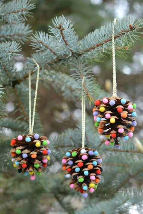 Pom Poms and Pinecones Christmas Ornaments: Add mini pom poms to basic pinecones to create a beautiful ornament with a creative twist. Find more easy handmade, glitter, photo, rustic, fabric, felt, painted and personalized DIY Christmas ornament ideas here.