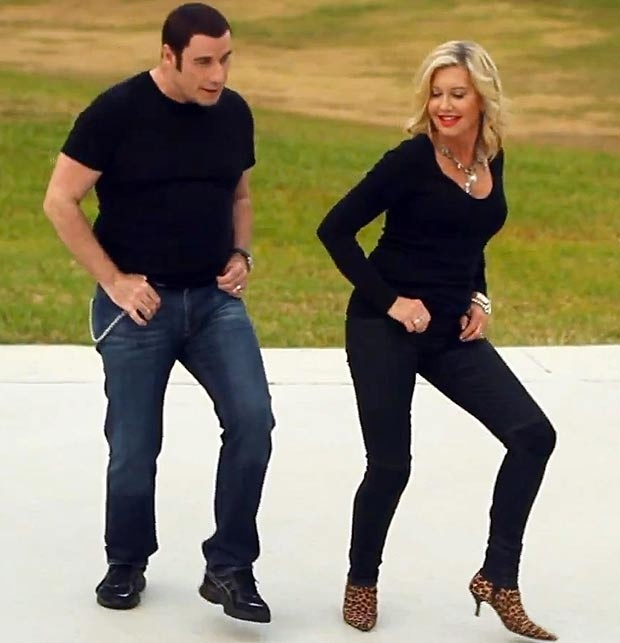 John Travolta and Olivia Newton-John. Looking back, it's so obvious!
