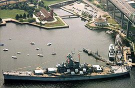 Fall River, Massachusetts - Battleship Cove, located here is a nonprofit maritime museum and war memorial that traces its origins to the wartime crew of the World War II battleship USS Massachusetts. This dedicated veterans group was responsible for the donation of the decommissioned vessel from the Navy and its subsequent public display here. BATTLESHIP COVE