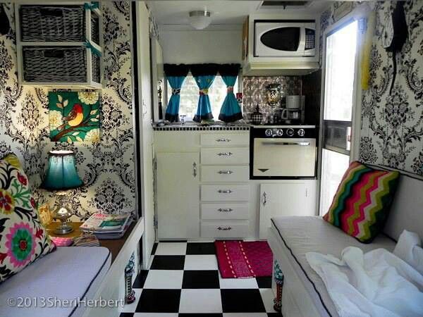love, love, love the wall paper in the trailer, rv.  I'm a little hesitant to wall paper my LQ horse trailer, but this sure makes me want to try. hum...