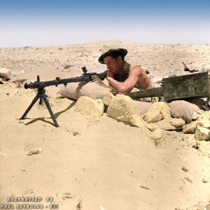 'First Battle of El Alamein' An Australian soldier, possibly from 26 Brigade, 9th Division (Australia) with a captured German MG.34 in a machine gun post near the strategic high ground around Tel el Eisa, north-west of Alamein, Egypt. 25th of July 1942.