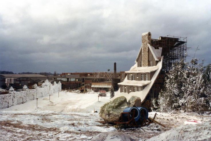 View of the The Shining's Overlook Hotel facade built on the backlot of Elstree Studios. The large grey building on the left is Stage 5, which housed the Gold Room set, as well as the Torrance family's Boulder Apartment set. The brick building in the mid-ground contained the Overlook's Kitchen set, while in the far background, Stage 3 and Stage 4 can be seen, which contained the enormous Colorado Lounge set and the Hotel Lobby set. (photo courtesy Prop Store)