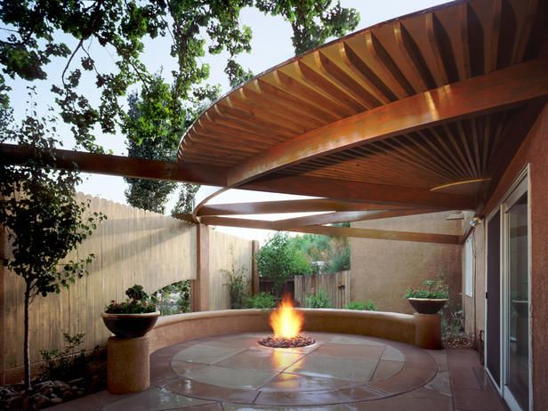 The breathtaking design of this patio's roof is equal parts form and function: The open areas accommodate colorful shade cloths in the summer and allow light in throughout the winter.
