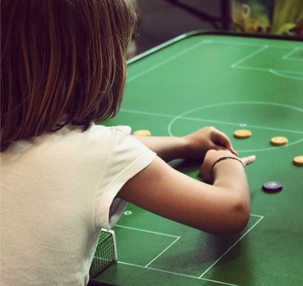 #Girl playing Button Soccer at Mundial Infantil Futbol Botons Barcelona 2014. #traditional game #buttons #tablegame #ButtonMakerBCN Photography by @HandmadePressHP