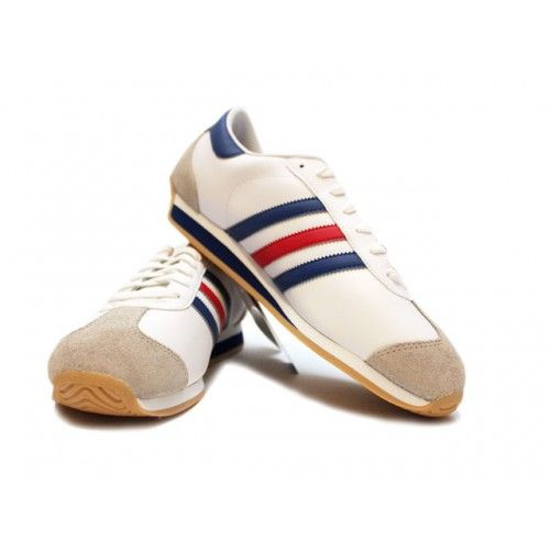 Adidas Country with Red Blue Stripes.  The Adidas Country sneaker is similar to the original Adidas Country with the same unique toe & heel wrap, made with with a smooth leather-upper and a die-cut EVA midsole for extra cushioning. Perfect for the golf course, track or court.