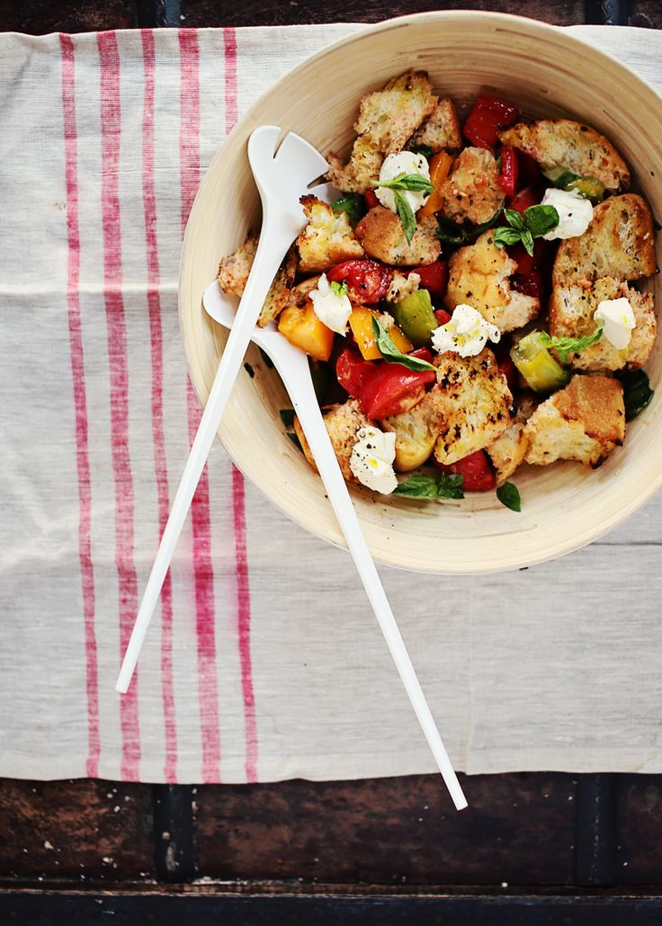 This amazing Panzanella (tomato and bread) salad recipe features slightly charred focaccia, juicy tomatoes, creamy mascarpone and an addictive vinaigrette.