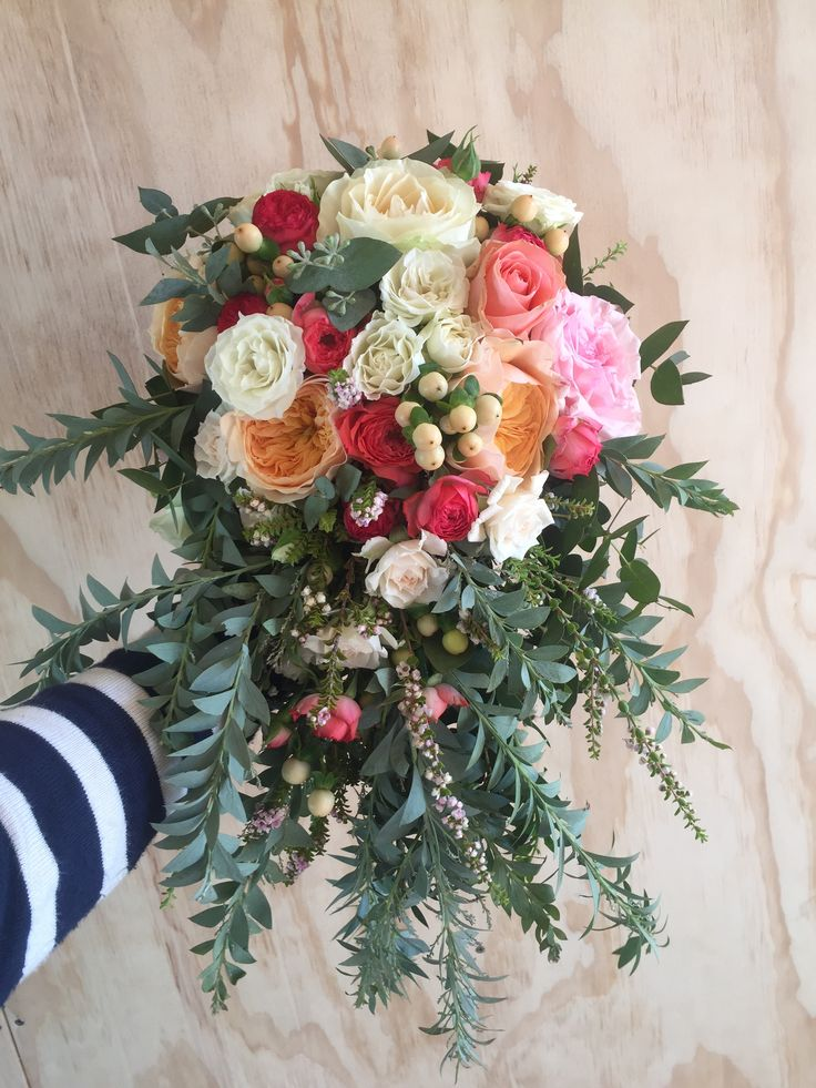 Bright and vibrant cascading, tear drop bride bouquet in coral, peach and pink colour tones. Designed and created by Madison in Bloom Floral Design. www.madisoninbloom.com.au https://www.instagram.com/madisoninbloom/ https://www.facebook.com/MadisoninBloom/