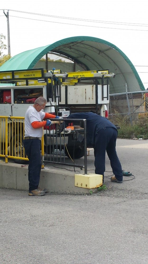 Wilcox tech's installing and fabricating a new Safety Rail.