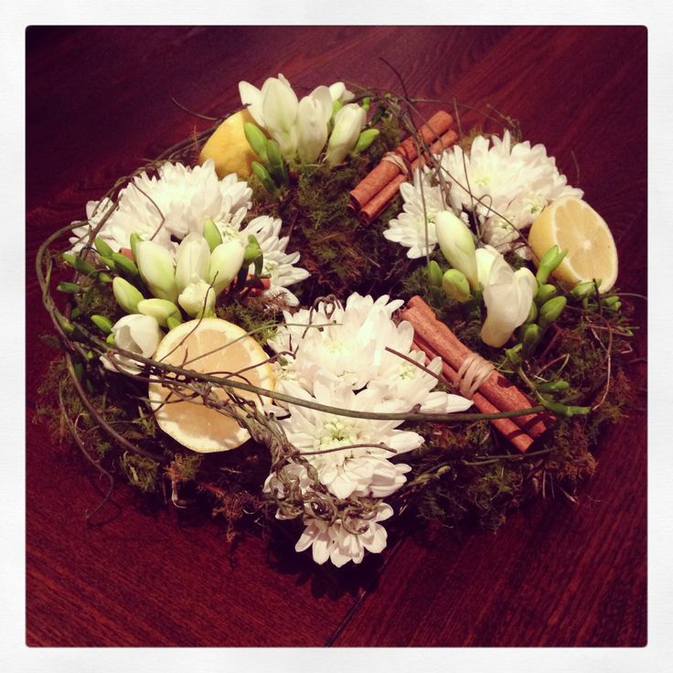 Lemon and cinnamon wreath with freesia and chrysanthemum...