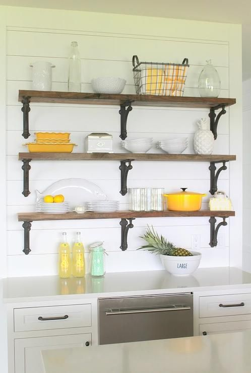 Wooden Shelves With Wrought Iron Brackets Are Stacked And Mounted
