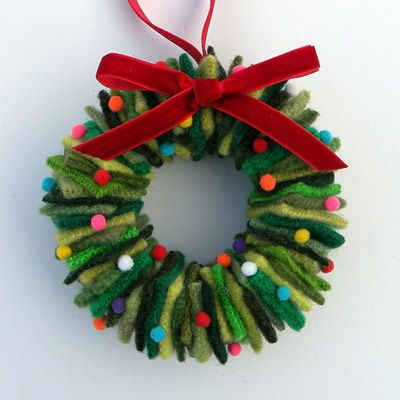 This adorable decorative wreath ornament is made using old wool sweaters cut into squares, threaded through a wire hanger and topped with a bow. Or you can buy them for under $8.00 from Alicia Todd at Etsy.com | thisoldhouse.com