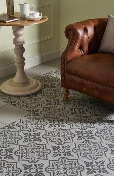 Original Style ODYSSEY PENTILLIE Dark Grey on Grey. Named after a grad castle perched on the edge of the river Tamar. Hints of the grandeur and elegance of Pentillie Castle are echoed in this design. Create a rug effect by running a border of the plain tiles around the edge. The lovely tracery pattern looks beautiful on walls as well as floors.