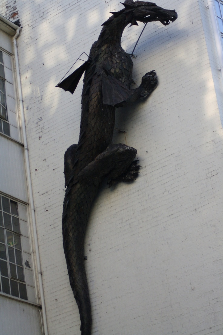 Dragon scaling a wall