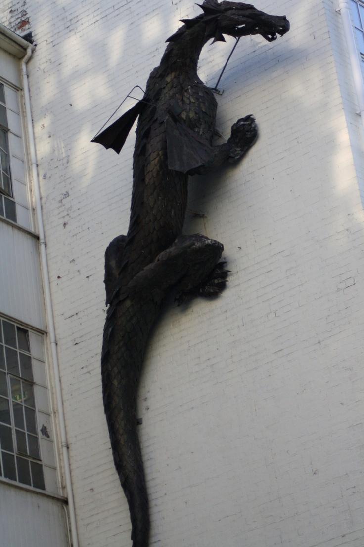Dragon scaling a wall