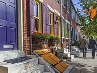 These houses in Philadelphia are in Rittenhouse square. They are traditional brick homes with pops of color, shutters, exposed cellars and window boxes full of flowers.