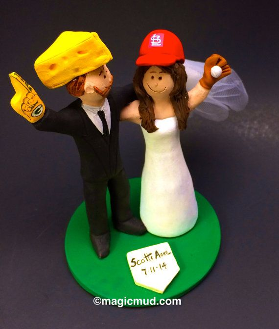 "Green Bay Packers ""Cheesehead"" Football Wedding Cake Topper, St. Louis Cardinals Wedding Cake Topper,  Wedding Cake Topper custom made    A fired clay NFL Wedding Cake Topper for a Football Fan's Marriage, custom created for you! Handmade to your specifications by magicmud.com     $235 #magicmud 1 800 231 9814 www.magicmud.com"