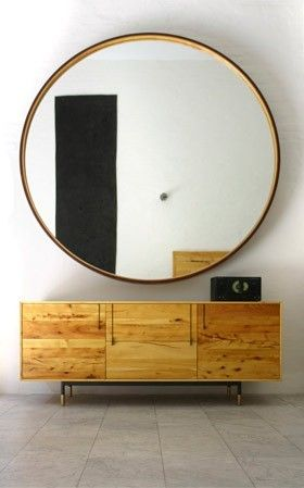 Oversized round mirror with drawers