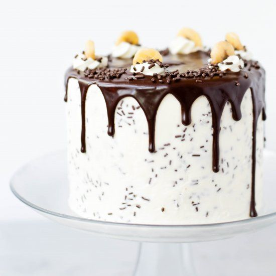 Banoffee Pie in Cake Form - Butter Cake Filled with Banana Toffee, covered in Vanilla Swiss Meringue Buttercream and Dark Chocolate.