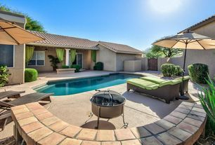 Southwestern Swimming Pool with Fence, exterior stone floors, Fire pit, Gate, Pathway
