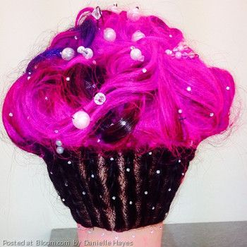 Cupcake hair for a hair competition at school! braids at bottom, updo on top, with color (pink/ purple) and beads and jewels.