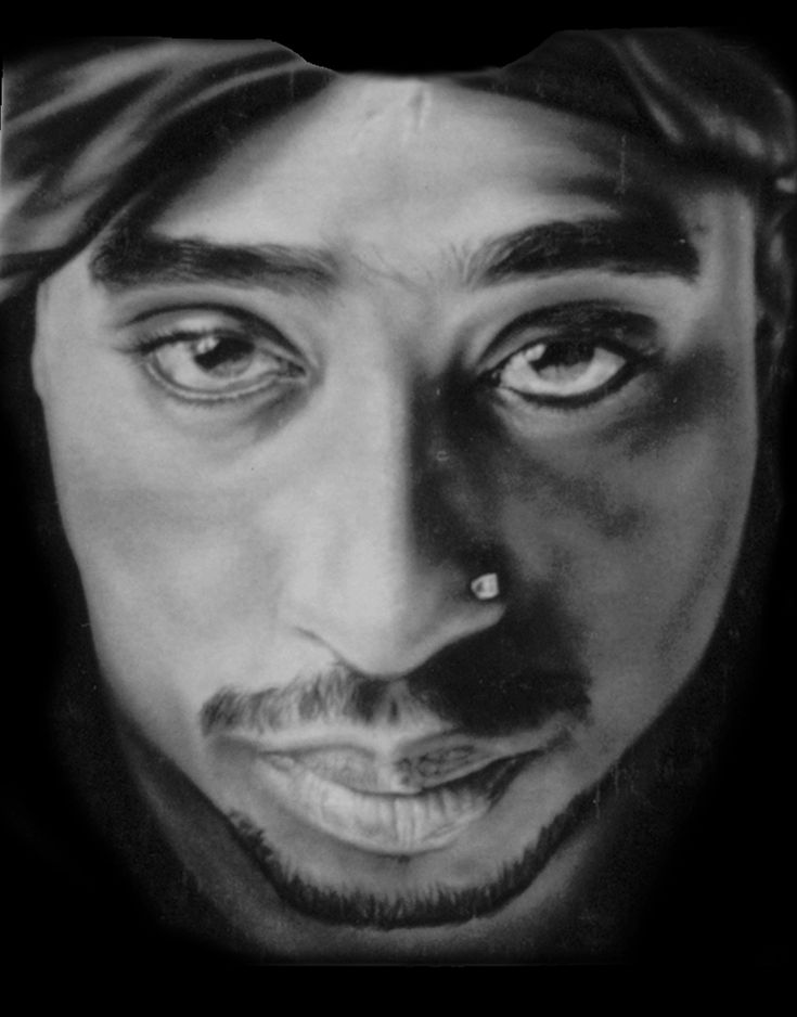 I'm not sure but I think this is 2Pac.  celebrities who are dead | Image Source