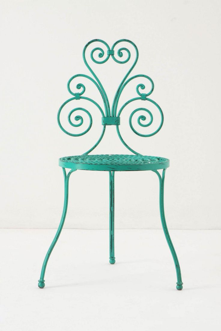 This lovely chair would also make a sweet little table/plant stand. @Melissa Crain Photography $248