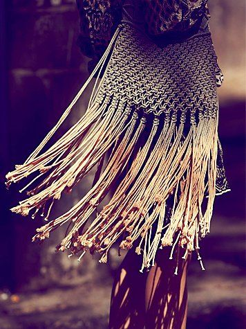 This beautiful ombre. dip-dyed, macrame bag with fringe trimming also had woven straps. There is a magnetic button closure at the top , and the inside is fully lined.  http://www.freepeople.com/whats-new/rio-marina-bag/