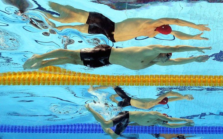 Michael Jamieson and Andrew Willis of Great Britain compete in the men's 200m breaststroke final