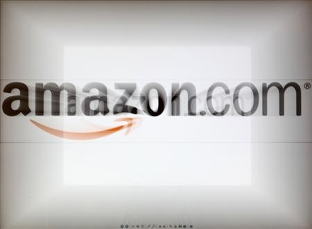 Amazon shares set record after strong quarterly profit: A zoomed image of a computer screen showing the Amazon logo is seen in Vienna November 26, 2012. REUTERS/Heinz-Peter Bader