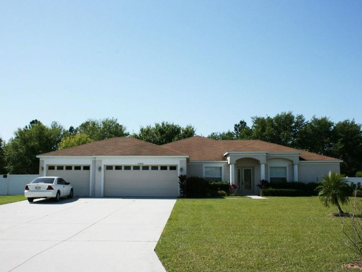 Pristine 4 2 3 contemporary home on an acre of land w rv for Rv garage homes florida