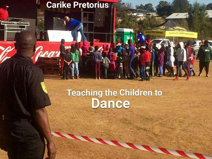 Under His Covering.  Carike Pretorius teaching the children to dance.