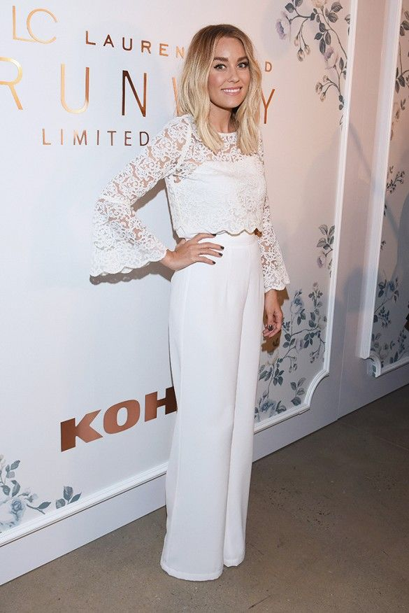 Lauren Conrad wears an LC Lauren Conrad Runway Collection scallop-lace crop top with high waist wide-leg pants and ankle strap heels.