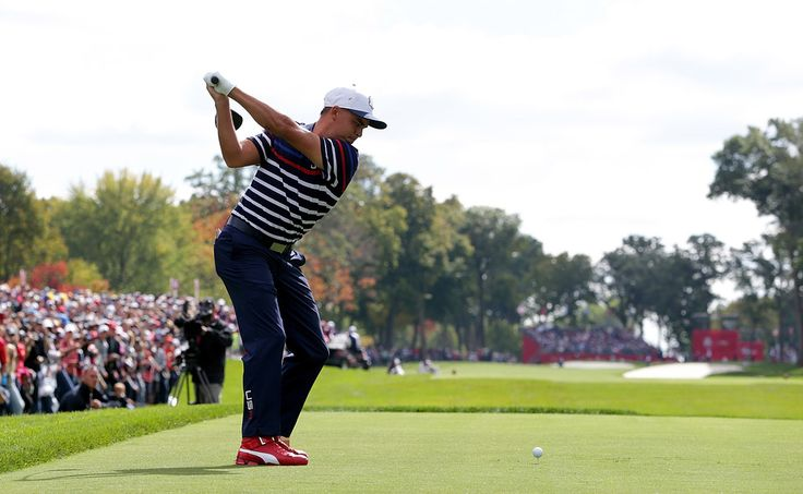 Rickie Fowler Photos Photos - Rickie Fowler of the United States plays a shot during practice prior to the 2016 Ryder Cup at Hazeltine National Golf Club on September 29, 2016 in Chaska, Minnesota. - 2016 Ryder Cup - Previews