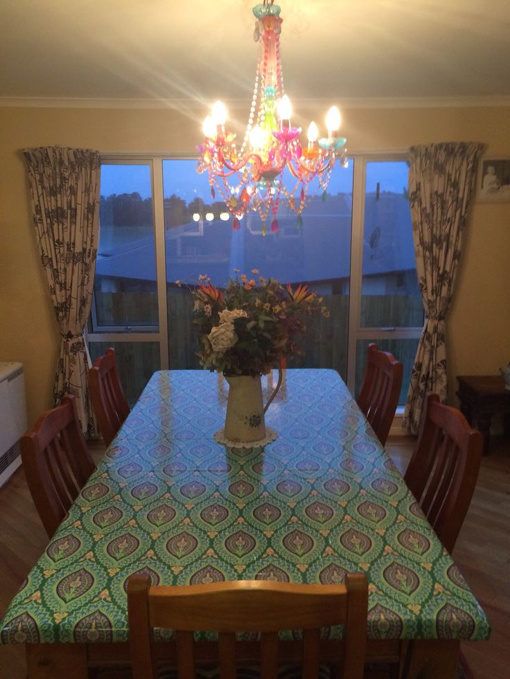 Dining table given a new look by a beautiful Amy Butler oilcloth....soooo pretty!