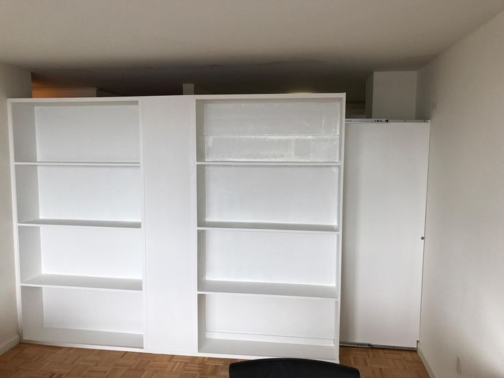 Recent Installation: Bookcase Wall With Pocket Door. Call Us For All Your  Custom Room
