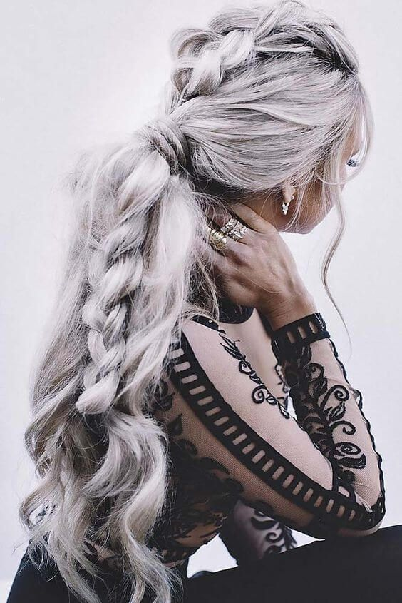 Trendy Fall Hair Colors: Woman with elaborate braid and silver hair