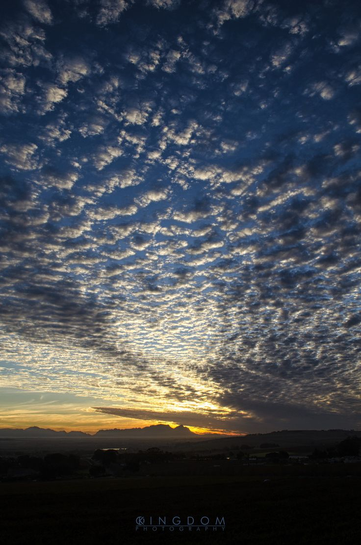 Sunset over Table Mountain as seen from Somerset West suburbs against the Helderberg mountain, Cape Town, South Africa by Ian Kitney. #somersetwest #tablemountain #capetown #sunset