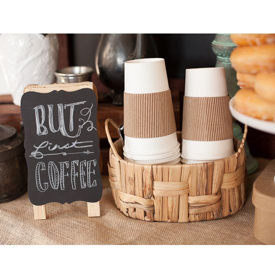 Perk up your morning sip and see with a DIY coffee and breakfast bar. Paula of Frog Prince Paperie created a coffee and cravings theme baby shower with all the essentials for a good morning—bagels, doughnuts, and, of course, coffee! Prepare a few different blends in insulated carafes: regular and decaf, plus a seasonal or flavored option for those with a more adventurous sipping style. Don't forget the cream and sugar!/