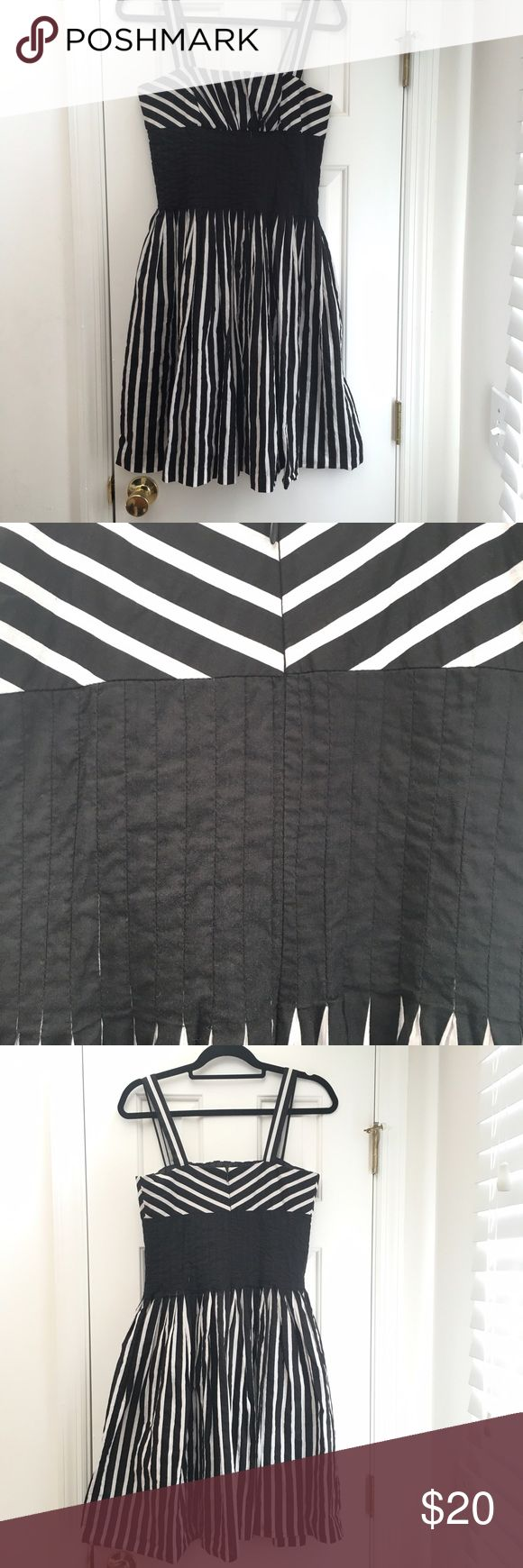 White House Black Market striped cocktail dress Adorable striped dress made by WHBM, that's been worn a few times.  It still has a lot of life in it and the stripes are so cute! This dress is a size 4. White House Black Market Dresses Midi