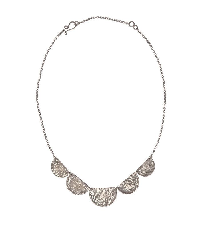 Nail the scallop trend with this stunning, hammered necklace.  Each item in Paisley + Sparrow's shop has a PURPOSE. This item is handcrafted by a survivor of modern day slavery.  www.paisleyandsparrow.com