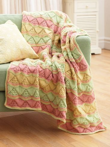 Free Pattern - A triangle lace pattern follows the multicolored stripes in this beautiful #knit blanket.