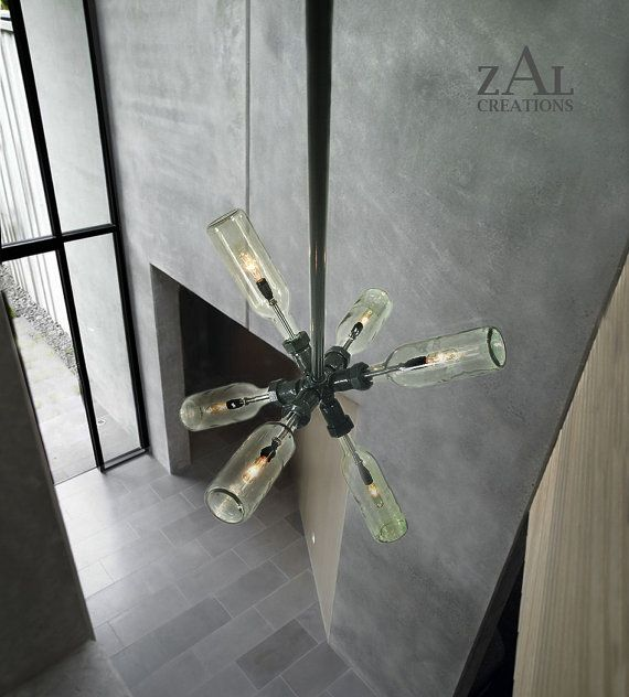 Hey, I found this really awesome Etsy listing at http://www.etsy.com/listing/164776747/starburst-chandelier-wine-beer-bottles