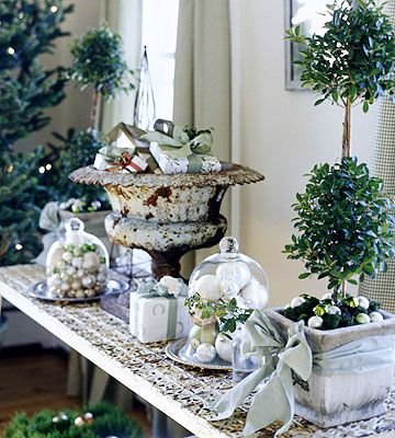 Garden Variety        Bring the look of a French garden indoors for the holiday season. Replace the usual sideboard with a cast-iron French garden table, and accent it with fresh topiaries, ornament-filled cloches, and a flea market urn filled with wrapped presents.