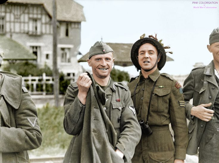 Québécois Sgt. R. Gagnon (right) of Le Régiment de la Chaudière, 3rd Canadian Division, poses with a German POW (left) on the Nan White sector of Juno Beach who seems relieved to have been captured during the Allied D-Day landings (Operation Neptune).  Juno Beach, Bernières-sur-Mer, Calvados, Lower Normandy, France, 6 June 1944. Image taken by Frank L. Dubervill.  #ww2 #britih #german #soldier #POW #prisoner #wwii #worldwar2