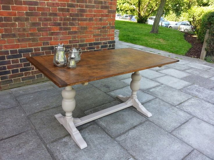 Antique oak table with stone eggshell base.